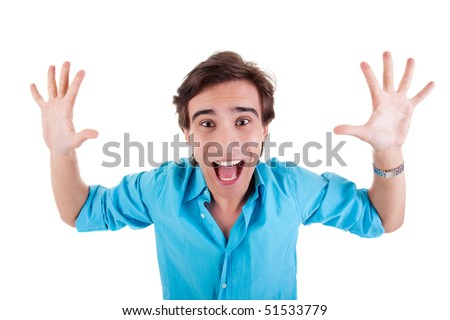 Portrait of a very happy young man with his arms raised, and hands open, on white background. Studio shot - stock photo
