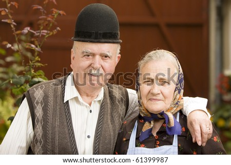 Portrait of a very old couple on country side. - stock photo