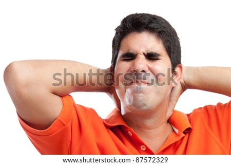 Portrait of a very stressed young hispanic man isolated on white - stock photo