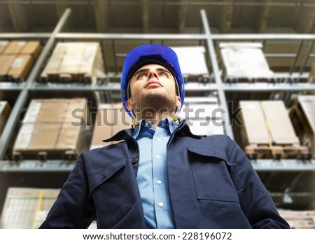 Portrait of a warehouse worker - stock photo