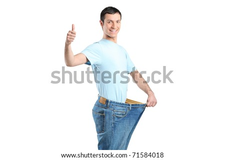 Portrait of a weight loss male with thumb up isolated on white - stock photo