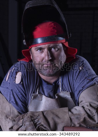 Portrait of a welder at his workplace