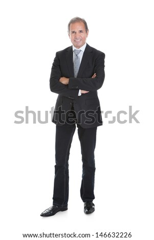 Portrait Of A Well Dressed Businessman Standing With Arms Crossed - stock photo