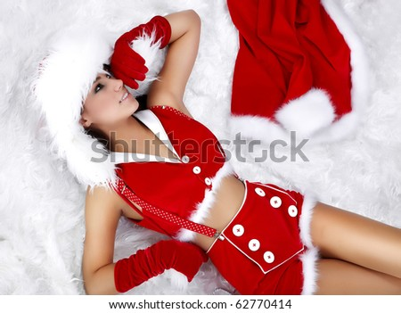 Portrait of a winter girl napping on white fur - stock photo