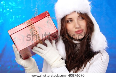 Portrait of a winter woman with gifts. Shot in studio. - stock photo