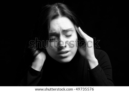 Portrait of a woman acting very stressed - stock photo