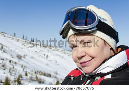 Portrait of a woman alpine skier in the lift