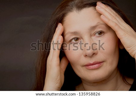 Portrait of a woman caring for her face. - stock photo