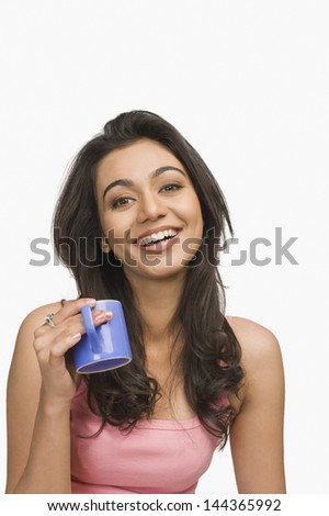 Portrait of a woman drinking coffee