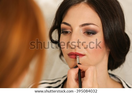Portrait of a woman getting make up