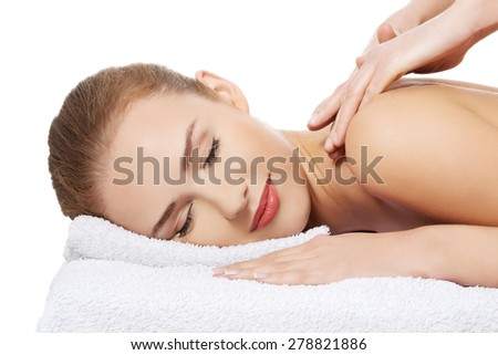 Portrait of a woman getting massage in spa.