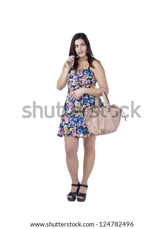 Portrait of a woman holding her bag and biting the handle of her glasses looking away on a white background