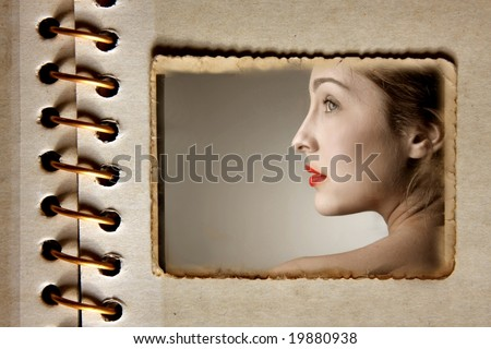 portrait of a woman in a vintage photo album - stock photo