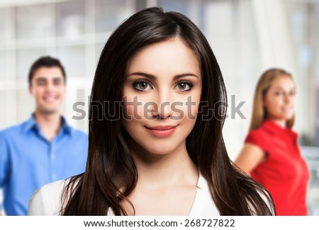 Portrait of a woman in front of her friends - stock photo