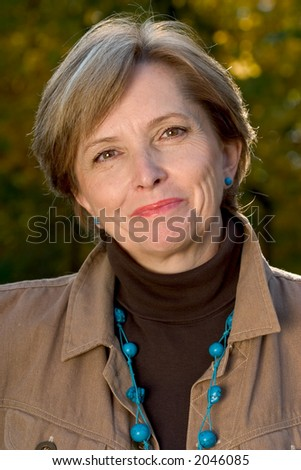 Portrait of a woman in her fifties. - stock photo