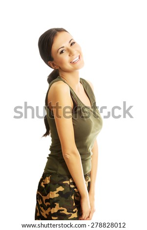 Portrait of a woman in military clothes smiling to the camera. - stock photo