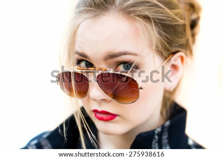 Portrait of a woman in sunglasses close-up, shallow depth of field - stock photo