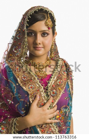 Portrait of a woman in traditional dress - stock photo