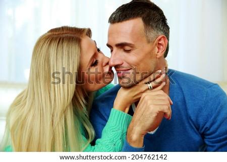 Portrait of a woman kissing his boyfriend - stock photo