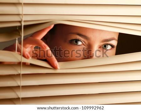 Black Man Behind Window Blinds Peering Stock Photo