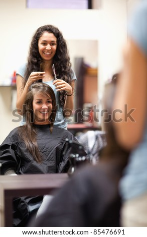 Portrait of a woman making a haircut standing up - stock photo