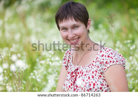 Portrait of a woman on chamomile background - stock photo