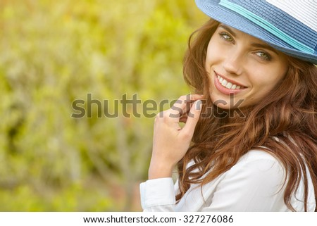 Portrait of a woman on green field in summer  - stock photo