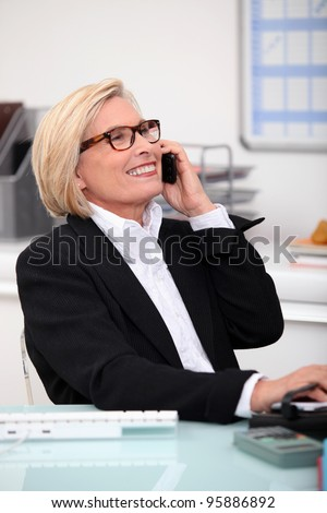portrait of a woman on the phone - stock photo