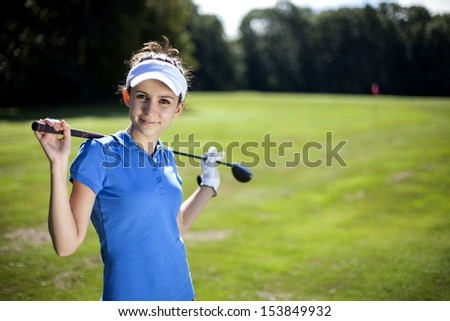 Portrait of a woman playing golf in summer - stock photo