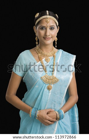 Portrait of a woman posing and smiling - stock photo