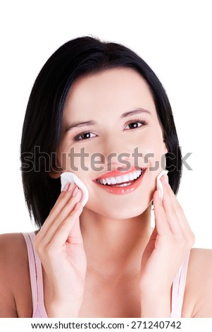Portrait of a woman removing makeup. - stock photo
