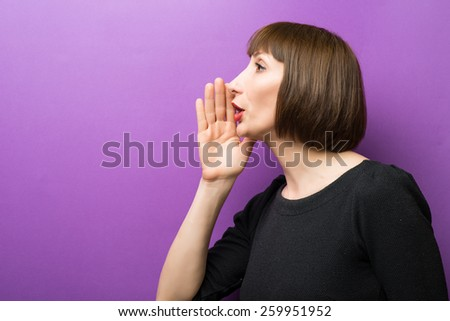 portrait of a woman scream hand on a purple background - stock photo