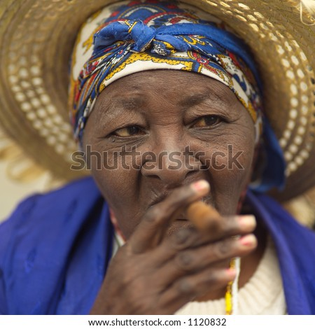 Portrait of a woman smoking a cigar, Havana, Cuba - stock photo