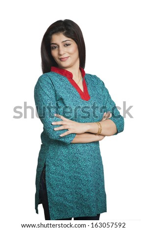 Portrait of a woman standing with his arms crossed - stock photo