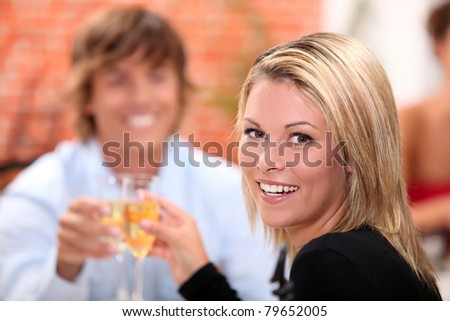portrait of a woman toasting - stock photo