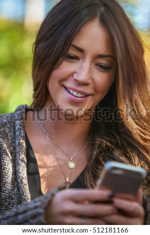 Portrait of a woman using her mobile device.