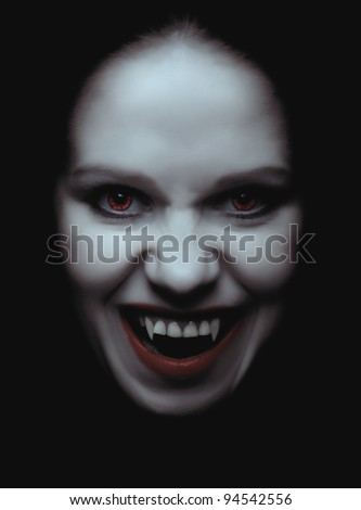 portrait of a woman vampire with fangs on a black background - stock photo
