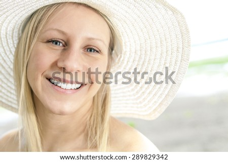 Portrait of a woman wearing a hat - stock photo