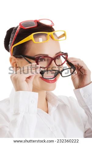 Portrait of a woman wearing many eyewear. - stock photo