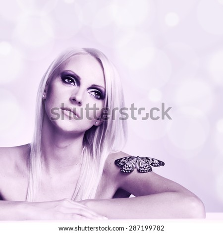 portrait of a woman with a butterfly - stock photo