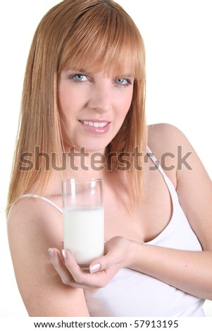 Portrait of a woman with a glass of milk - stock photo