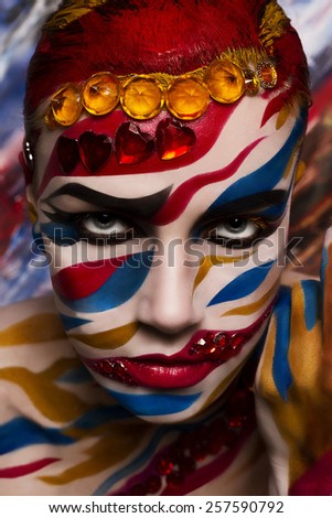 Portrait of a woman with a painted face. Creative makeup and bright style. - stock photo