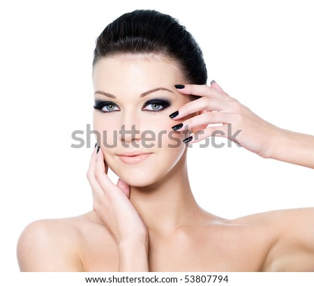 Portrait of a woman with Beautiful black eye make-up and beauty manicure - stock photo