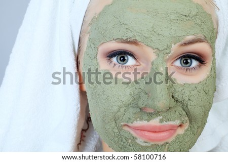 Portrait of a woman with beauty mask on her face. Spa, healthcare. - stock photo