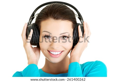 Portrait of a woman with big headphones. - stock photo