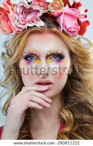 Portrait of a woman with elegant hairstyle and make-up close-up - stock photo