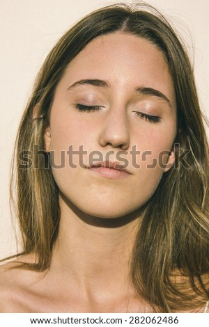 Portrait of a woman with eyes closed - stock photo