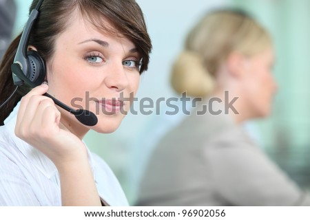 portrait of a woman with headset - stock photo