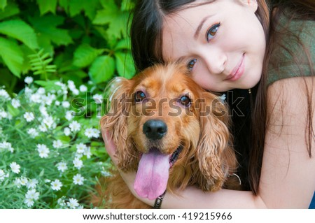 Portrait of a woman with her beautiful dog - stock photo