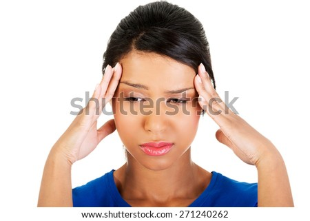 Portrait of a woman with huge headache. - stock photo